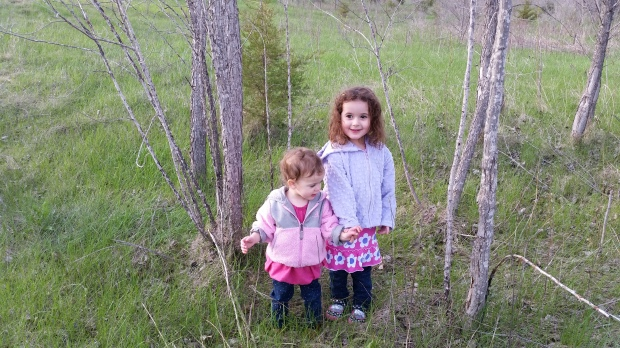 The girls exploring in one of the empty lots of our neighborhood during one of our walks