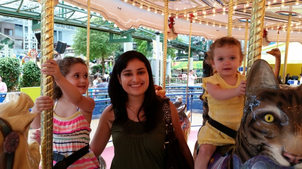 My friend with the girls on the carousel